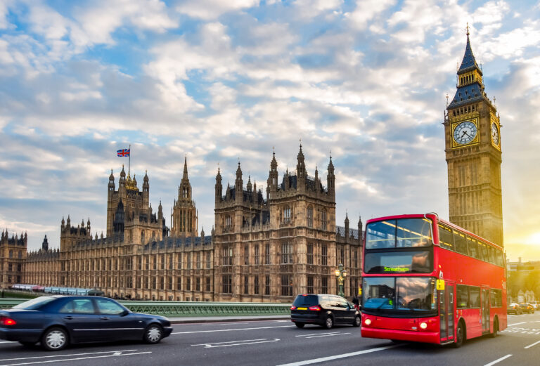 Houses Of Parliament With Big Ben And Double Decker Bus On Westminster Bridge At Sunset, London, Uk